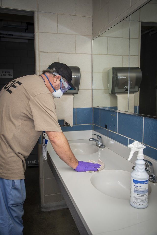 Facilities Technicians continue to disinfect commonly used areas