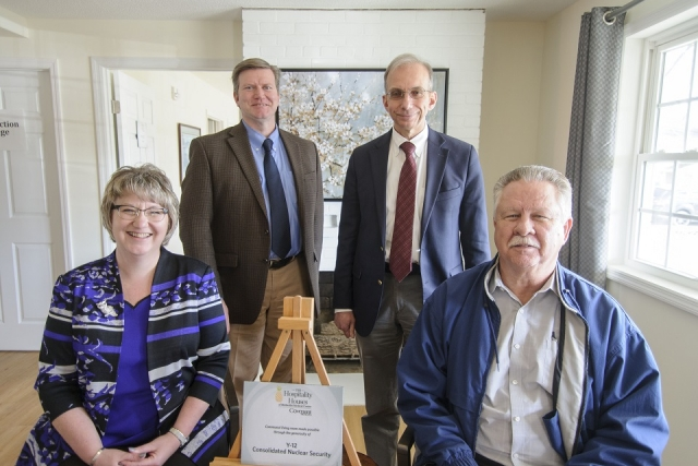 CNS Vice President and Deputy Enterprise Manager Michelle Reichert, Vice President and Y-12 Site Manager Bill Tindal, President and Chief Executive Officer Morgan Smith and Atomic Trades and Labor Council President Mike Thompson in the living room of Methodist Medical Center of Oak Ridge's third hospitality house.