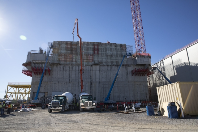 Crews at the Main Process Building pour concrete to complete it's first wall placement for the third level.
