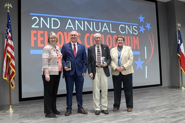 Chief Operating Officer Michelle Reichert (left) and CNS Vice President Linda Bauer (right) congratulate the latest CNS Fellows: Neil Koone (left) and John Prazniak.