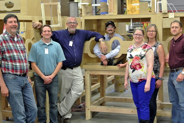 Project team members from Y‑12 and Merrick & Company during evaluation of the electrorefining glovebox mock‑up at the fabrication facility.