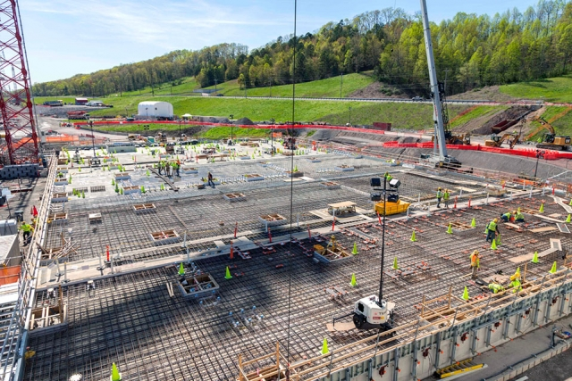 Concrete crews finish the base slab for the Salvage and Accountability Building. Placement of the topping slabs is underway.