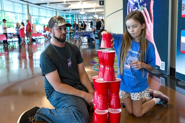 A father and daughter participate in some of the hands-on activities at Bring Your Children to Work Day.