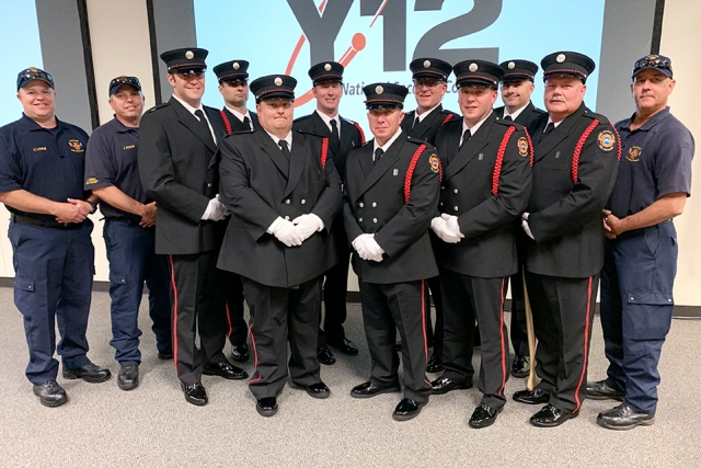 Pantex Honor Guard members Jeremy Baker (left), Chris Lewis (second from left), and Bobby Nash (far right) train the newly formed Y-12 Fire Department Honor Guard whose members include (starting third from left): Ben Norton, Doug Allen, Joe Herrell, Brandon Hitchcock, Lee Scofield, Jonathan Rood, Craig Shaver, Josh Bray and Bob Strunk.