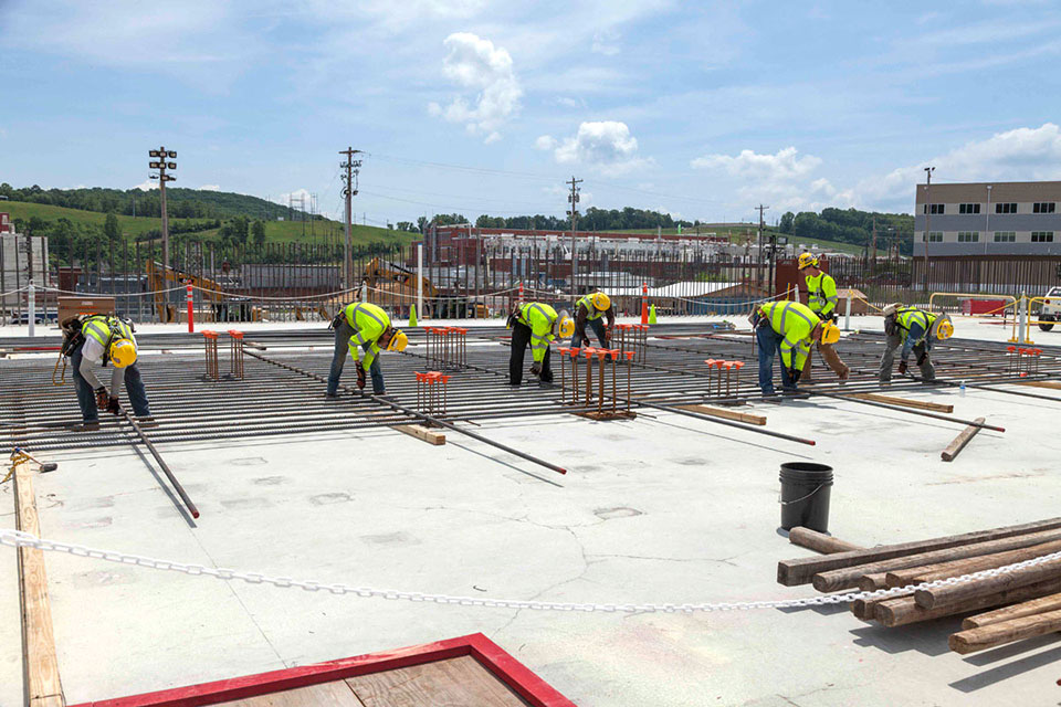 Skilled ironworkers position rebar for a wall curtain at the Main Process Building.