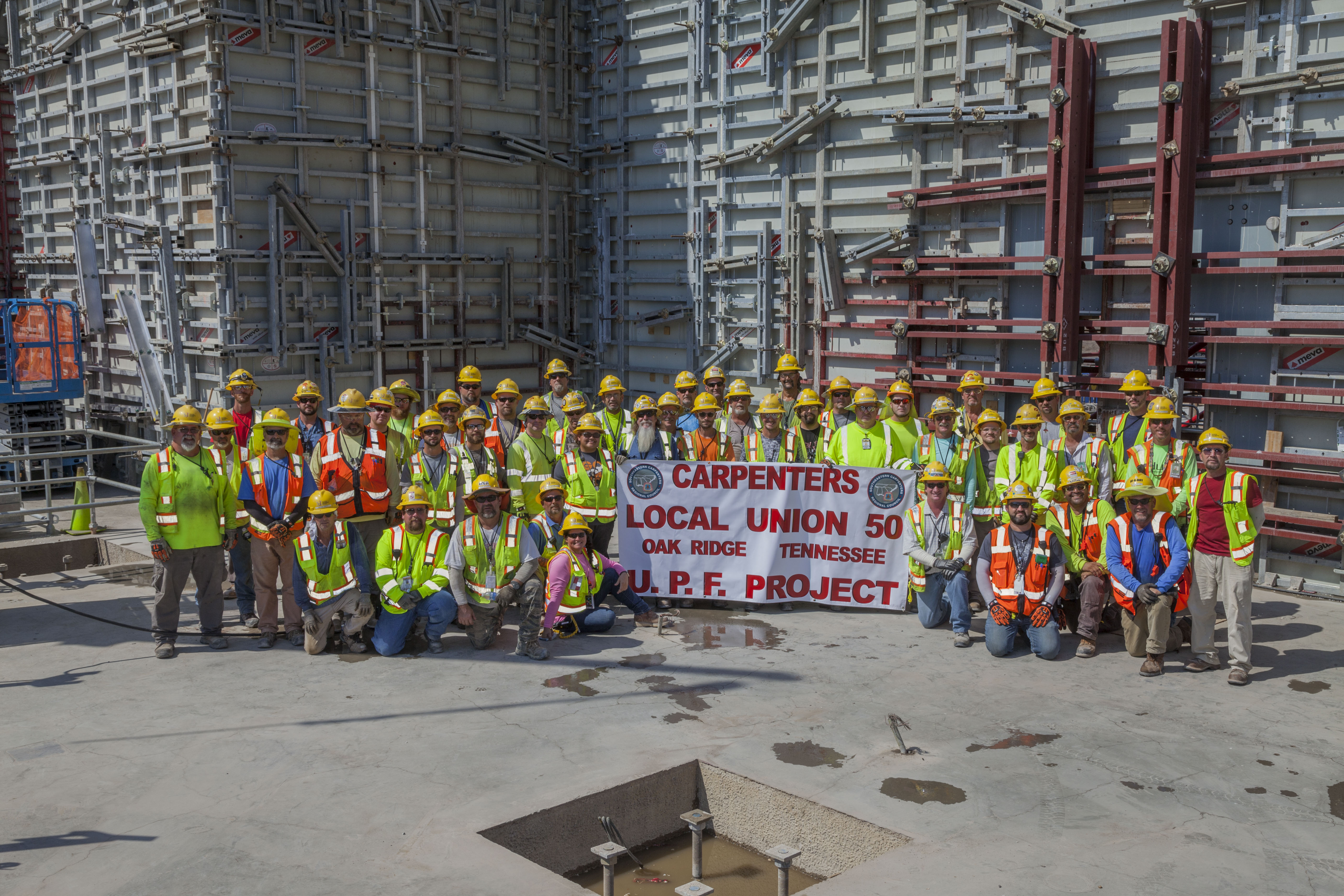 Uranium Processing Facility carpenters celebrate completion of Main Processing Building first level walls.