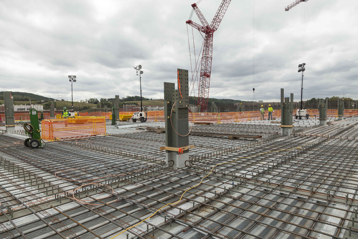 Rebar, embeds, and penetrations are installed on the second level of the Uranium Processing Facility Main Process Building to prepare for upper deck concrete placements.