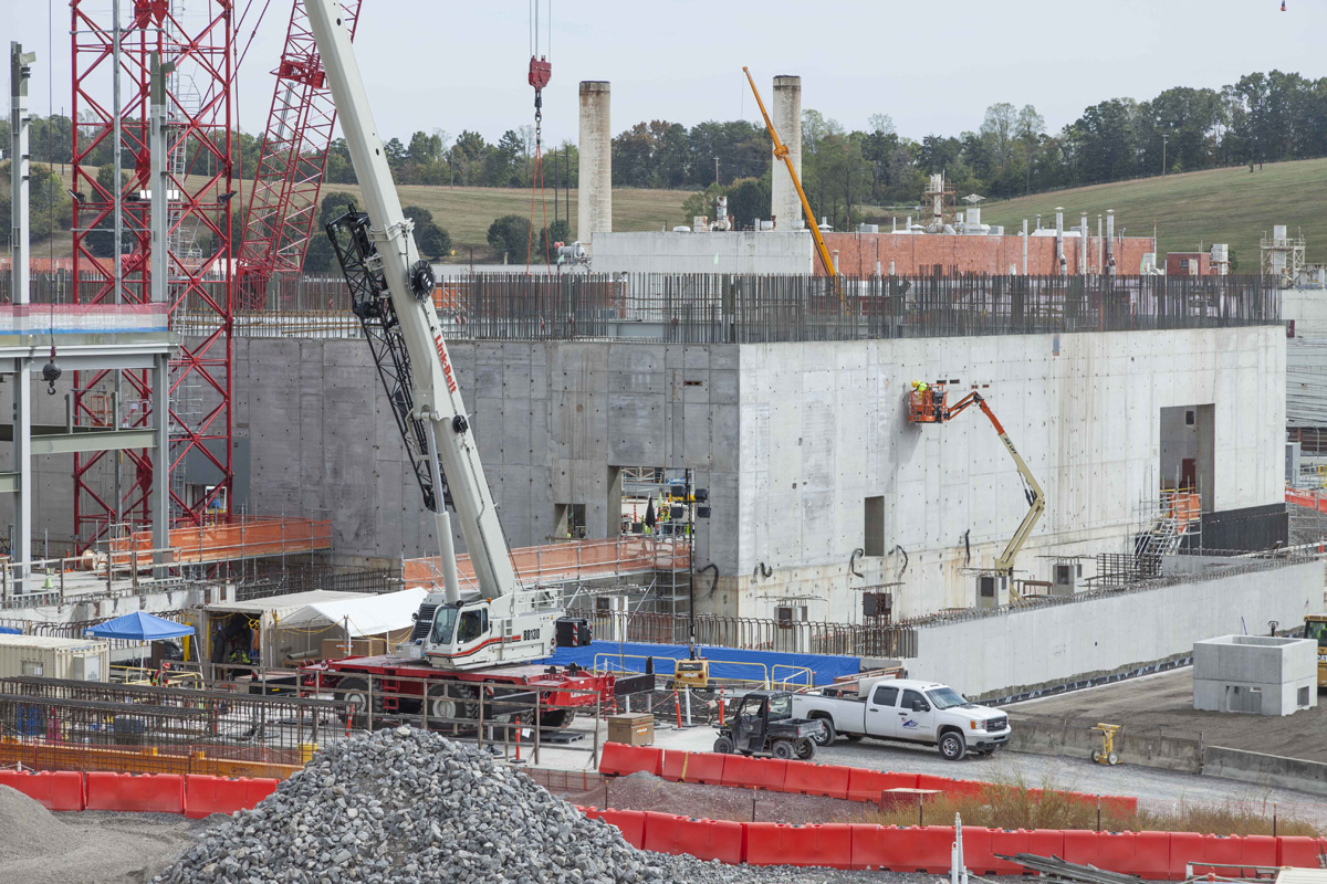 Members of the skilled craft workforce conducts finish work on the Uranium Processing Facility Main Process Building first level walls.