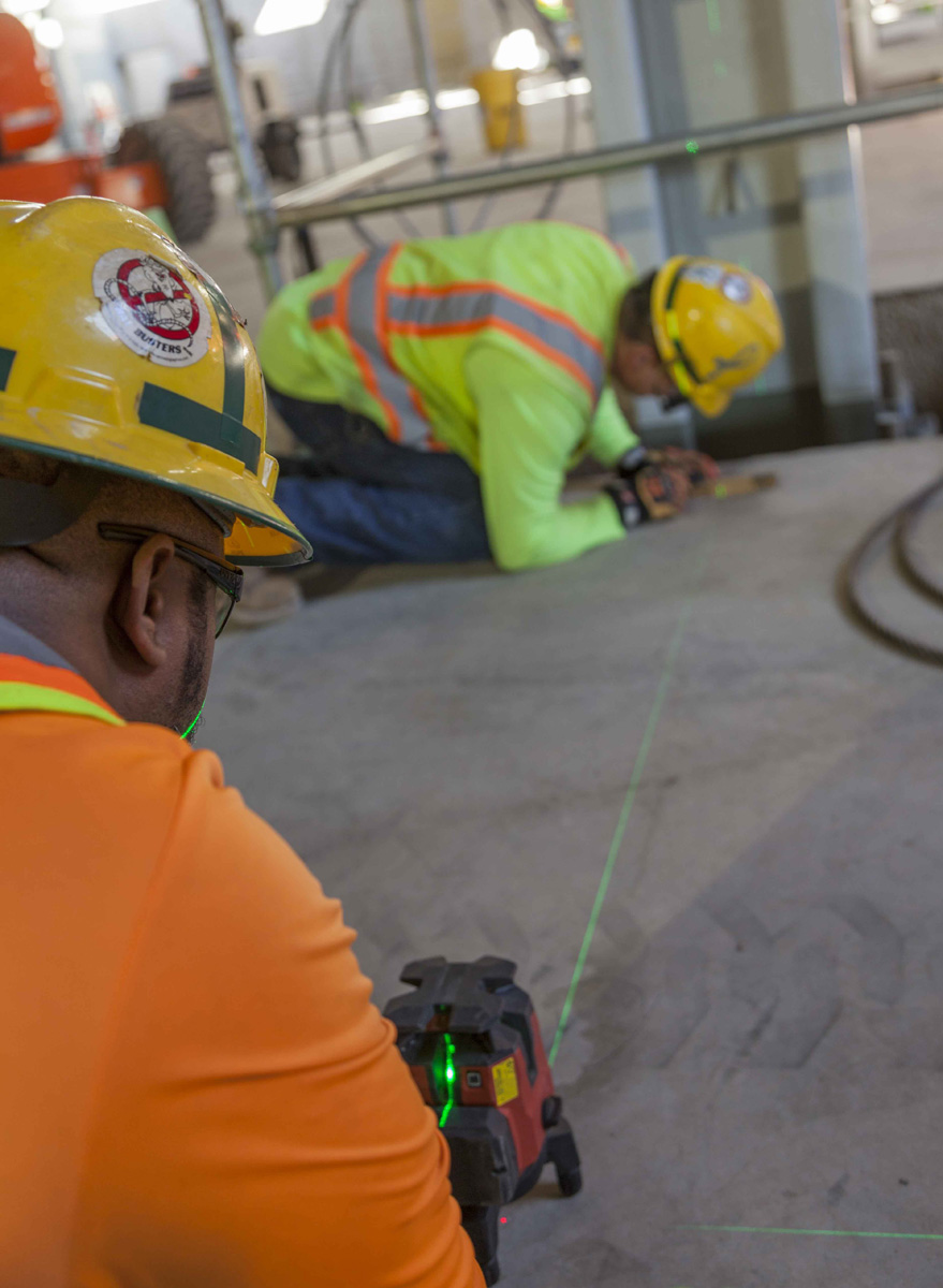 A Uranium Processing Facility (UPF) crew performs layout work in the UPF Salvage and Accountability Building.