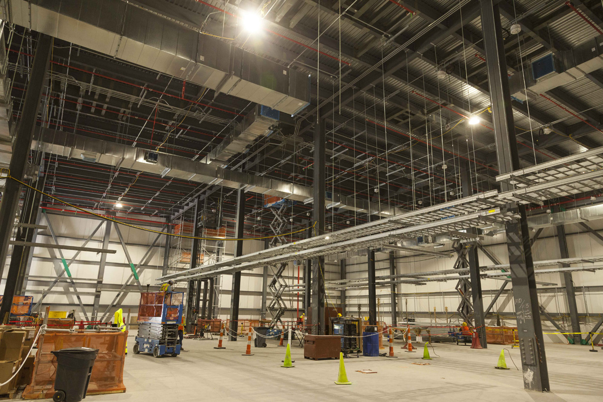 Cable tray supports, cable tray, and heating, ventilation, and air conditioning equipment is installed on the Uranium Processing Facility Mechanical Electrical Building second floor.
