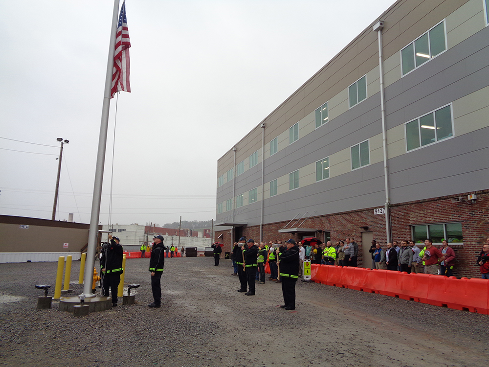 Uranium Processing Facility veterans are recognized during a ceremony outside the Construction Support Building.