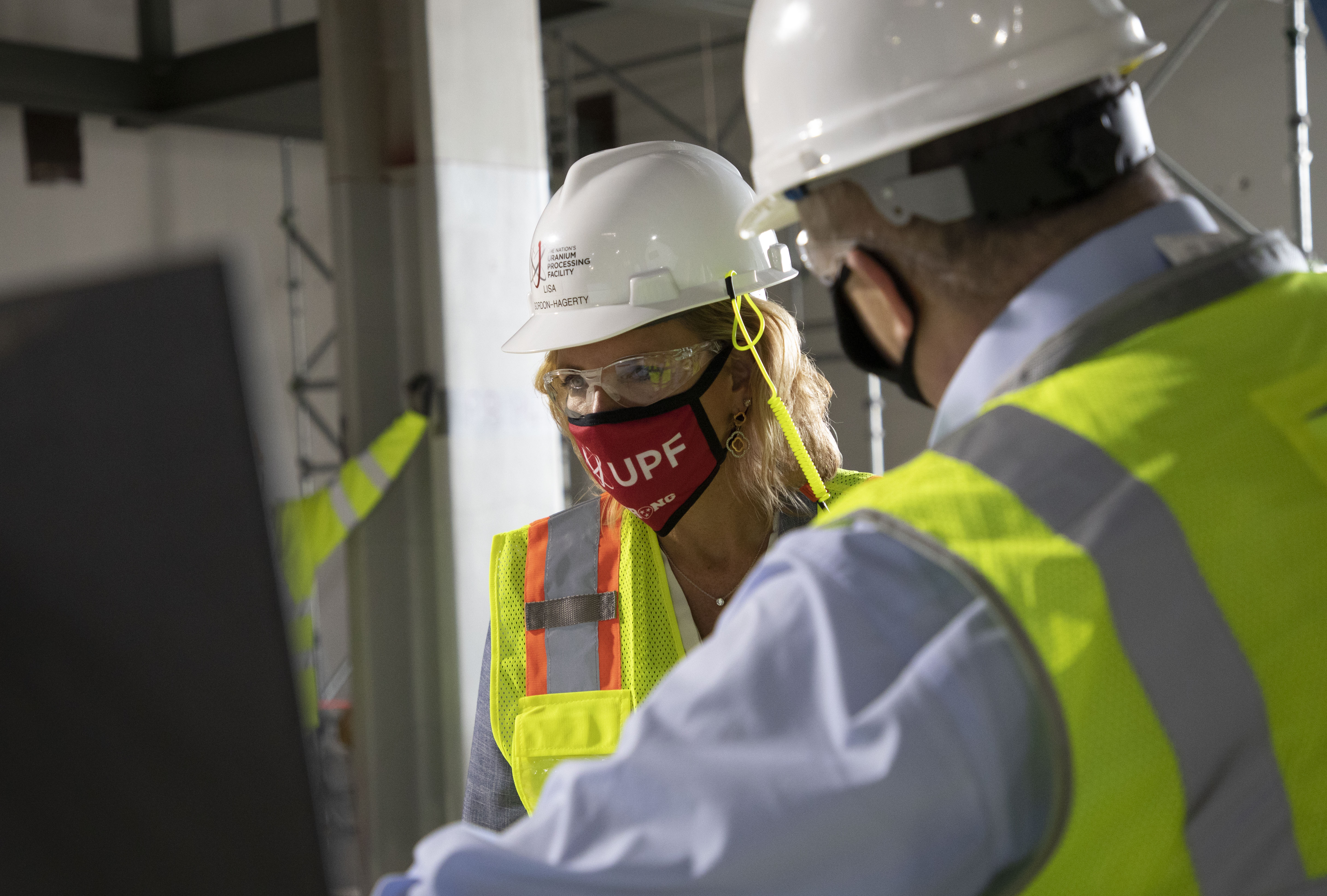 NNSA Administrator Lisa E. Gordon-Hagerty studies a rendering at the UPF Salvage and Accountability Building