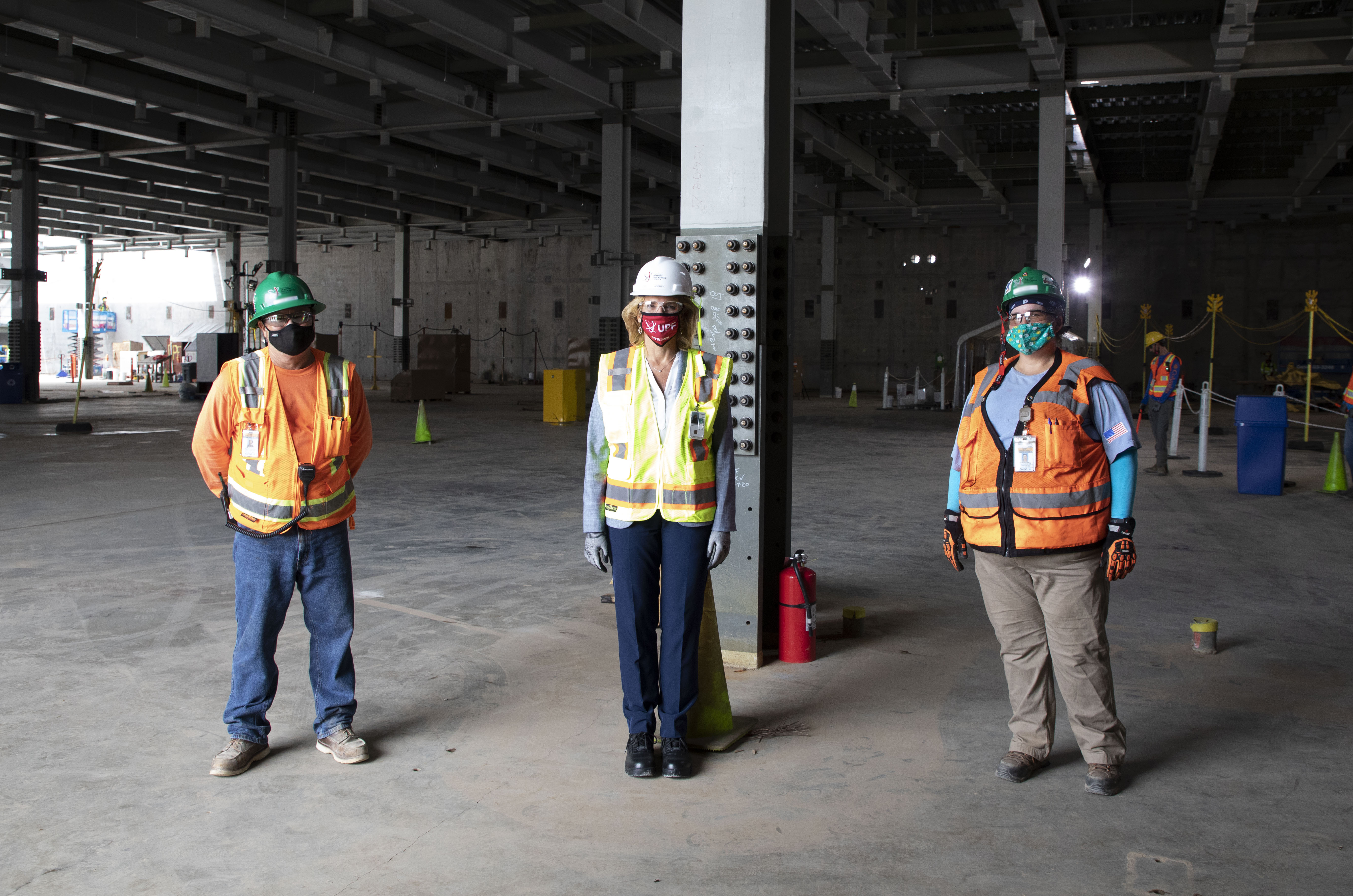 NNSA Administrator Lisa E. Gordon-Hagerty (center) with UPF Iron Workers in the Main Process Building