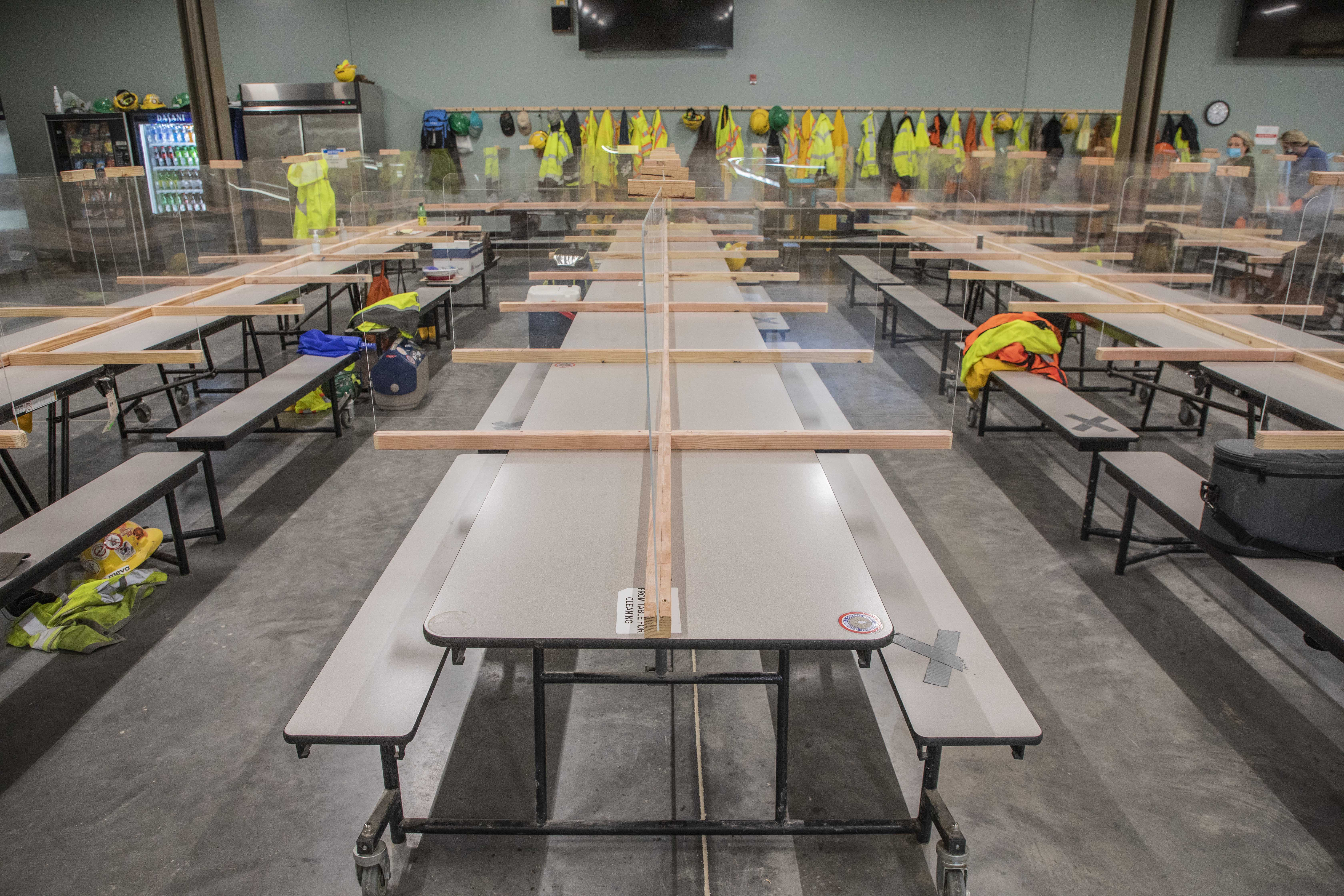 As part of the project's COVID-19 safety actions, plexiglass partitions were installed and placed on breakroom tables to maximize social distancing while eating.