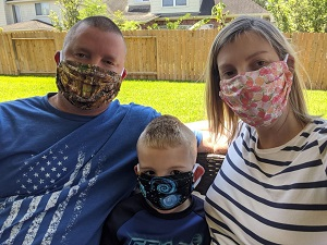 Former Y-12 employee Sheila Gideon and her family wear masks made by Jennifer Lawson and her sister.