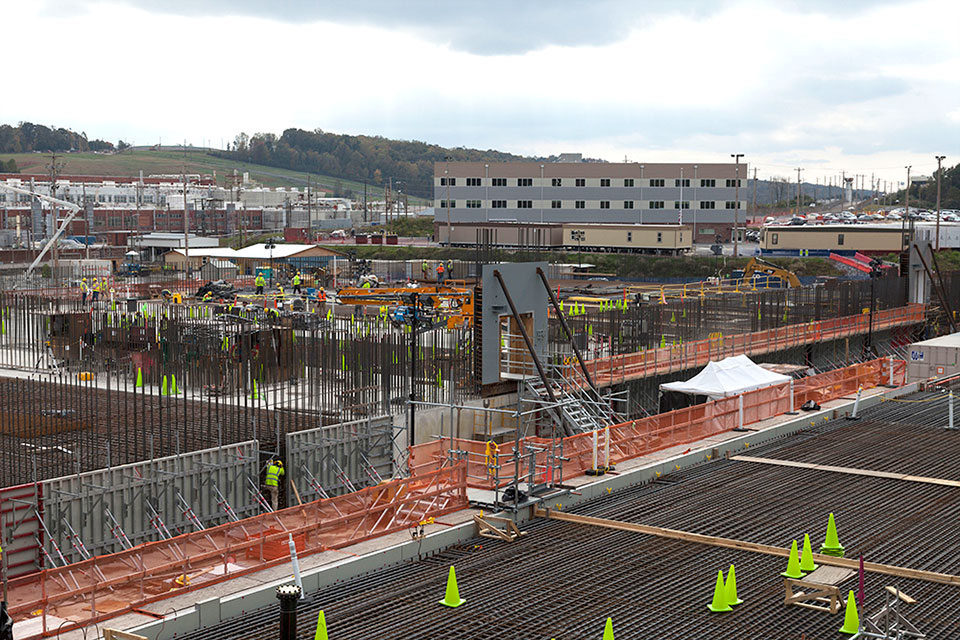 Rebar is being placed for the walls of the Main Process Building. The square frame is for an emergency egress door and weighs 22,000 lbs.