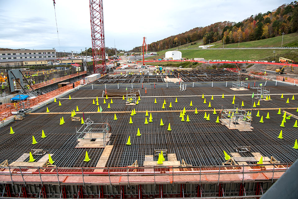 Cones protect the electrical grounding system of the Salvage and Accountability Building (SAB) until concrete is placed for the foundation. SAB will contain waste preparation, decontamination, non-destructive assay and chemical recovery support systems.