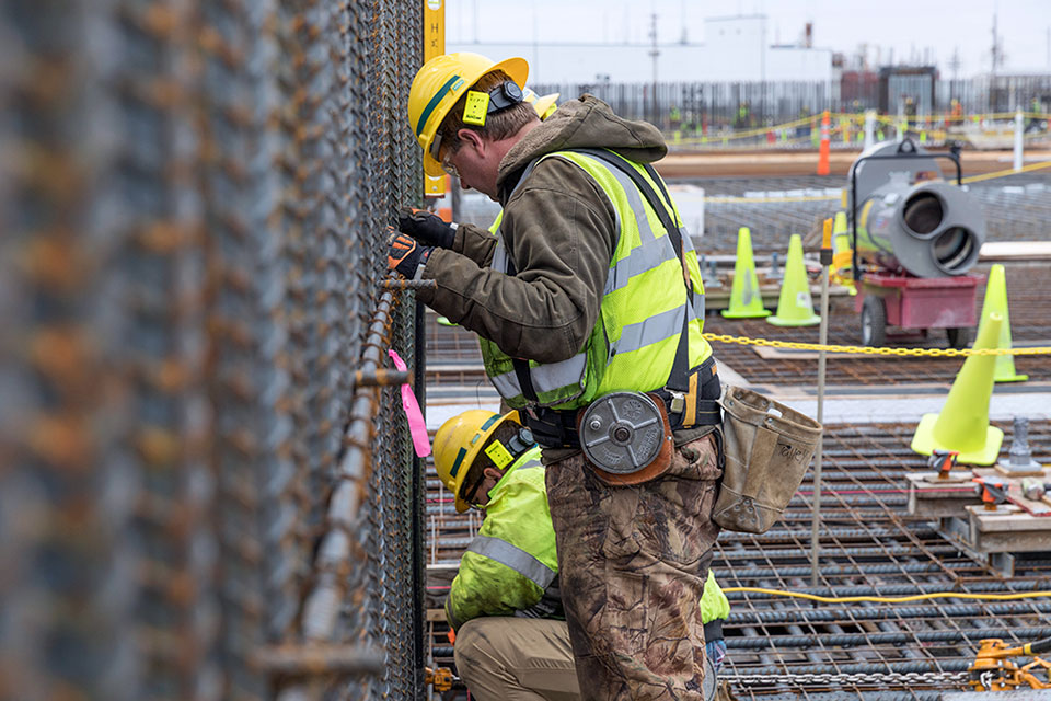 In addition to placing concrete for the base slab of the Main Process Building, crews also placed rebar for the walls.