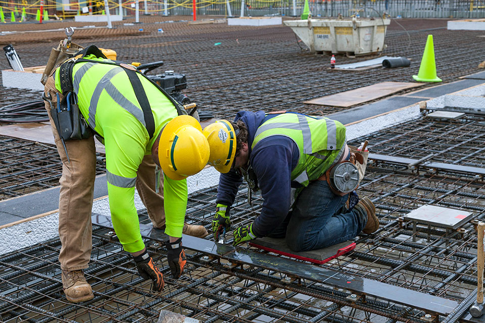 In addition to placing concrete, crews are installing rebar and embeds on the west topper slab of the Main Process Building.