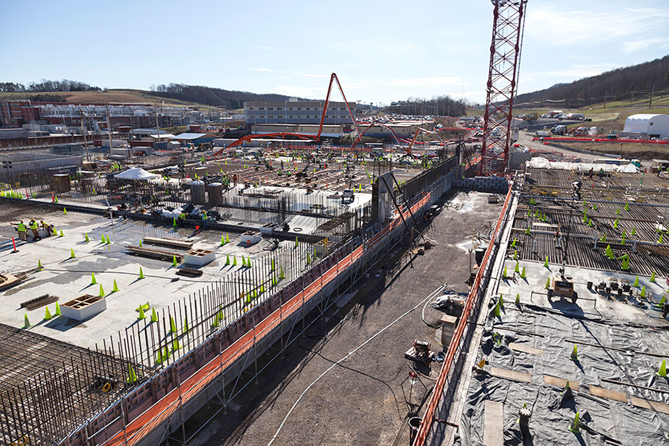 This view of part of the UPF construction site shows the Main Process Building on the left and the Salvage and Accountability Building on the right.