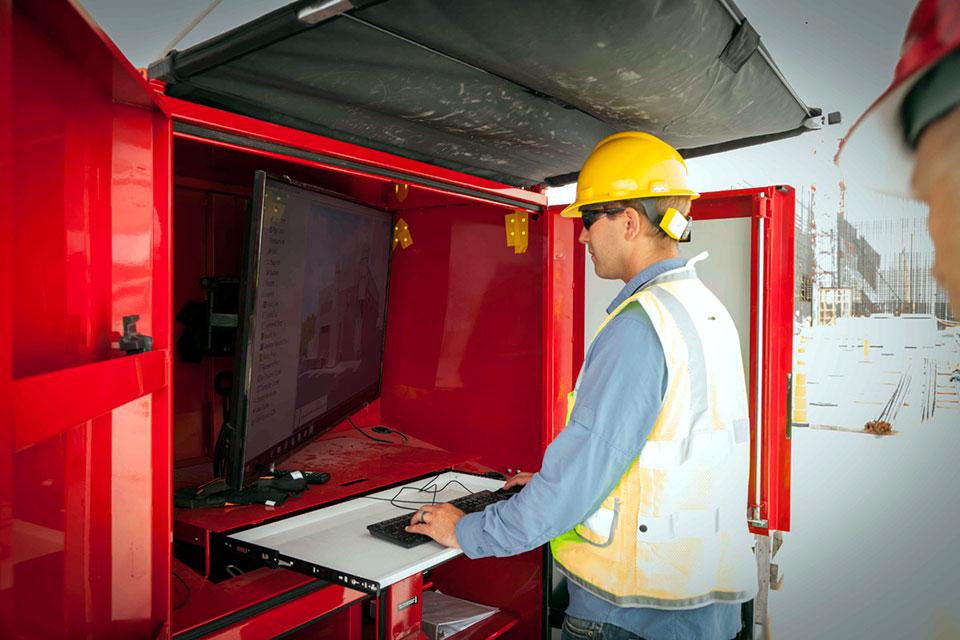 A Uranium Processing Facility (UPF) civil field engineer uses a computer located on the UPF construction site to access 3-D models of the buildings and work packages.