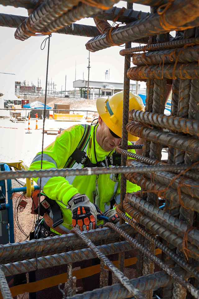Detailing begins on rebar once the walls are up at the Main Processing Building at Uranium Processing Facility.