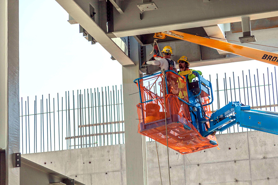 Ironworkers install structural steel pieces in the first level of the Uranium Processing Facility Salvage and Accountability Building.