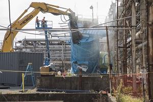 Crews demolish a Building 9201-05 (Alpha 5) dust collector tower at Y-12.