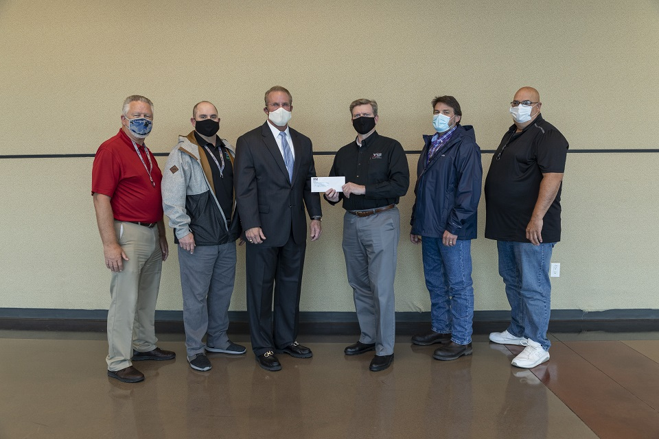 ETF President and CEO Michael McClamroch (third from left) receives a $500 donation through Y-12's Safety Challenge