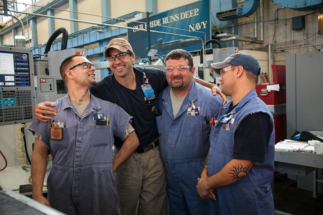 From left: Apprentice machinists John Bryant, Justin Dupas, Brice Graham and Jeff Bryant share a laugh and camaraderie on the shop floor.