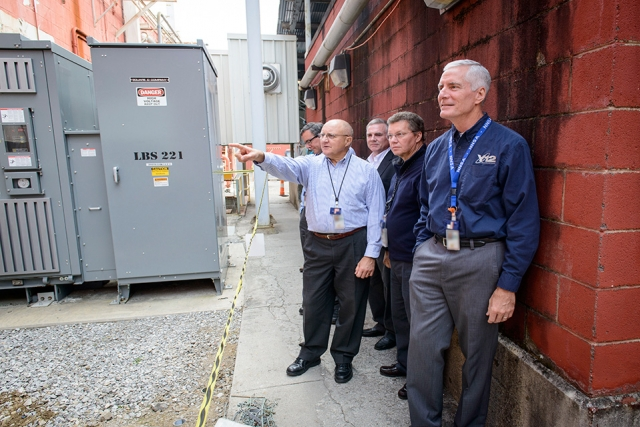 NPO Program Manager David Wall points out infrastructure upgrades to NNSA Uranium Program Manager Tim Driscoll, front, during a recent tour of Y‑12's Building 9995.