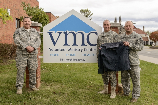 Veterans and current Y‑12 Security Police Officers delivered former uniform coats to the Volunteer Ministry Center.