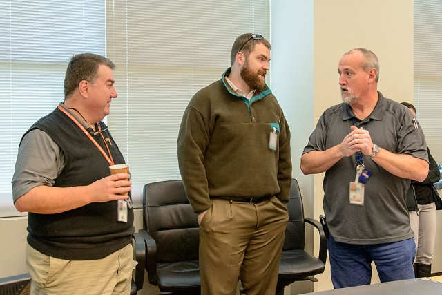 UT's Howard Hall and John Gill and Jeff Knott (Y-12) discuss battle board strategies.
