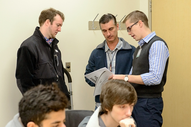 Y-12's Dan Romano (center) serves as the controller for the blue team.