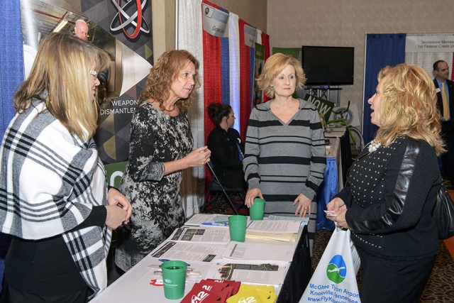 From left: Connie Polson, Elaine Najmola and Lisa Copeland discuss opportunities with a participant at the Tennessee Veterans Business Association Expo.