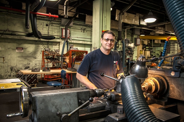 Machinist Apprentice Michael Lovelady operates a lathe in Building 9201-1 graphite shop.