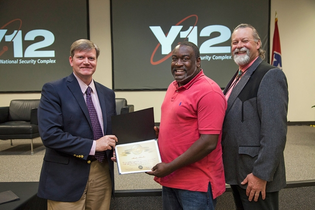 Y-12 Site Manager Bill Tindal (left) and NPO Manager Geoff Beausoleil (right) congratulate electrician graduate Andre Blocker on successful completion of the Y-12 Apprentice Program.