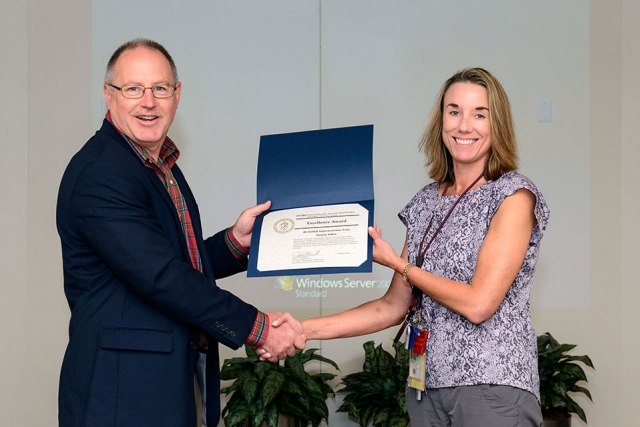 Melanie Dillon accepts the NNSA Excellence Award from James McConnell.