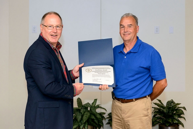Dwain Coppenger (right) accepts the NNSA Excellence Award from James McConnell.