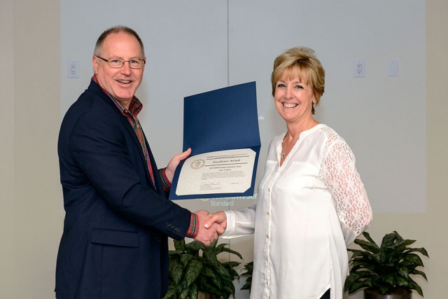 Jane Nations accepts one of her two NNSA Excellence Awards from James McConnell associate administrator for Safety, Infrastructure and Operations.
