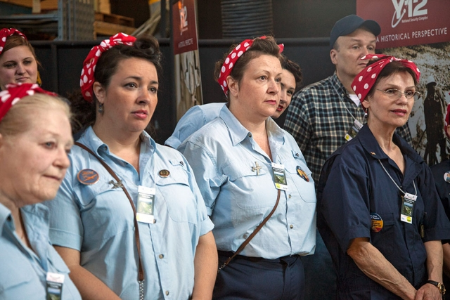 Women dressed as the World War II icon Rosie the Riveter tour Y‑12 during the Secret City Festival.