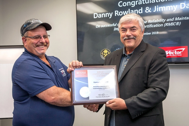 "Y-12's Danny Rowland, left, receives his Reliability and Maintainability Implementation Certification from UT's Dr. Klaus Blache. ""Once you understand how reliability and maintainability best practices impact operational efficiency and effectiveness, it's much easier to focus work on what really matters,"" Blache said."