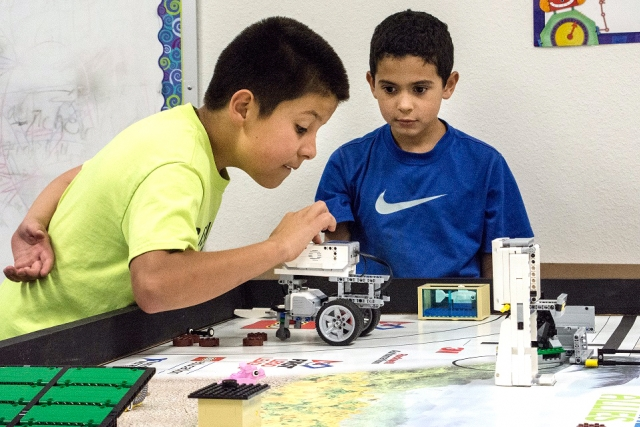 Bushland Independent School District robotics team members take turns testing their robots on the FIRST LEGO League practice field.