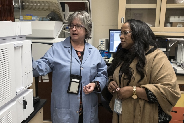 Stephanie Steelman (left) shows Nicole Nelson-Jean, NNSA Governance Committee chair and Savannah River Site manager equipment at the Pantex chemistry lab.