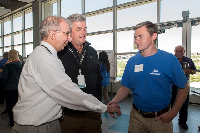 Evan from @school (right) talks with Morgan Smith (left) and Mike Beck at the Pantex Intern Expo.