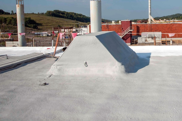 Significant prep work was required to seal and frame penetrations at Building Alpha‑5, but the new commercial foam roofing material will result in a significant reduction in facility flooding and water leakage.