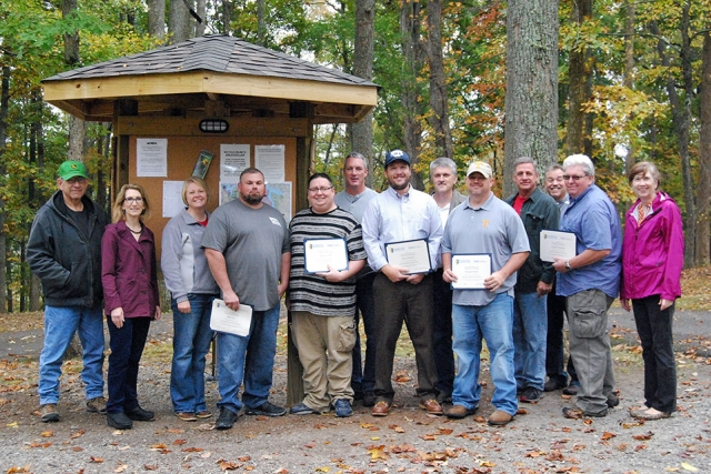 Members of the Y-12 journeyman machinist apprentice class gather at Norris Dam State Park to celebrate completing the classroom portion of their training. (Photo courtesy of Christine Jessel Grider/PSTCC.)