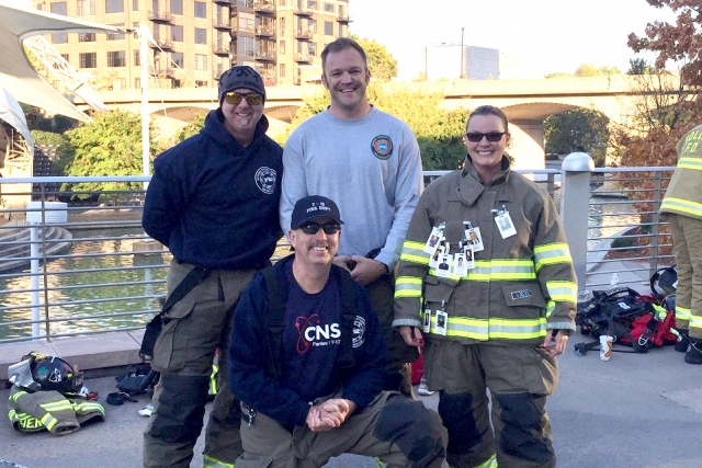 Y-12 firefighters (from left) Tom Bratcher, Ben Norton, April Allen and Fire Chief Scott Vowell (kneeling) participate in the 2016 National Fallen Firefighters Foundation Memorial Stair Climb at the Knoxville Sunsphere.
