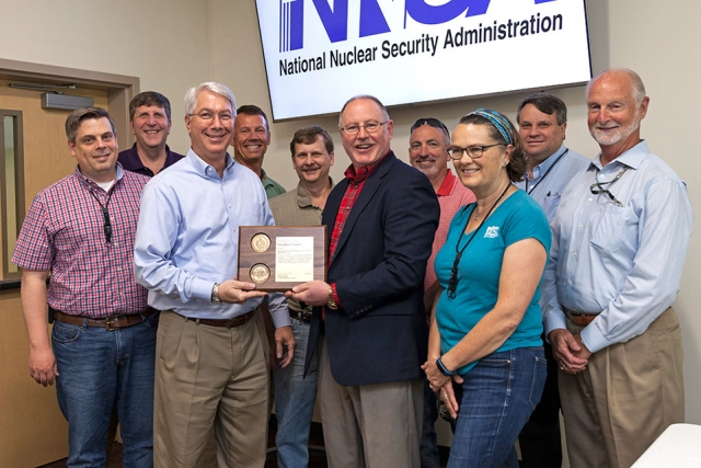 Members of the team who demolished Buildings 9111, 9112, and 9616-10 receive an Award of Excellence from Jim McConnell.