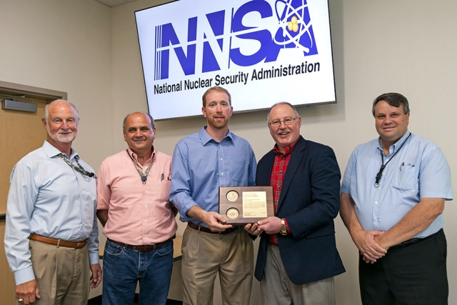 National Nuclear Security Administration's Associate Administrator for Safety, Infrastructure and Operations Jim McConnell (second from right) presents an Award of Excellence for Construction Work Processes Improvements.
